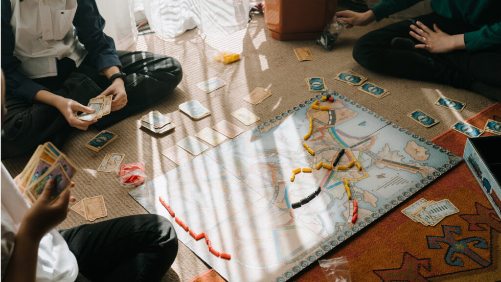 kids playing a board game on the floor